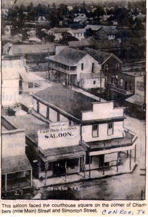 The old Corner Drug Store (Collier Building) is found in the background as a white corner building with a second-floor balcony. Old Conroe on the east side of the tracks can be seen in the top of this photo taken from the top of the old Courthouse. This photo was taken prior to the big fire that destroyed much of downtown in February 1911