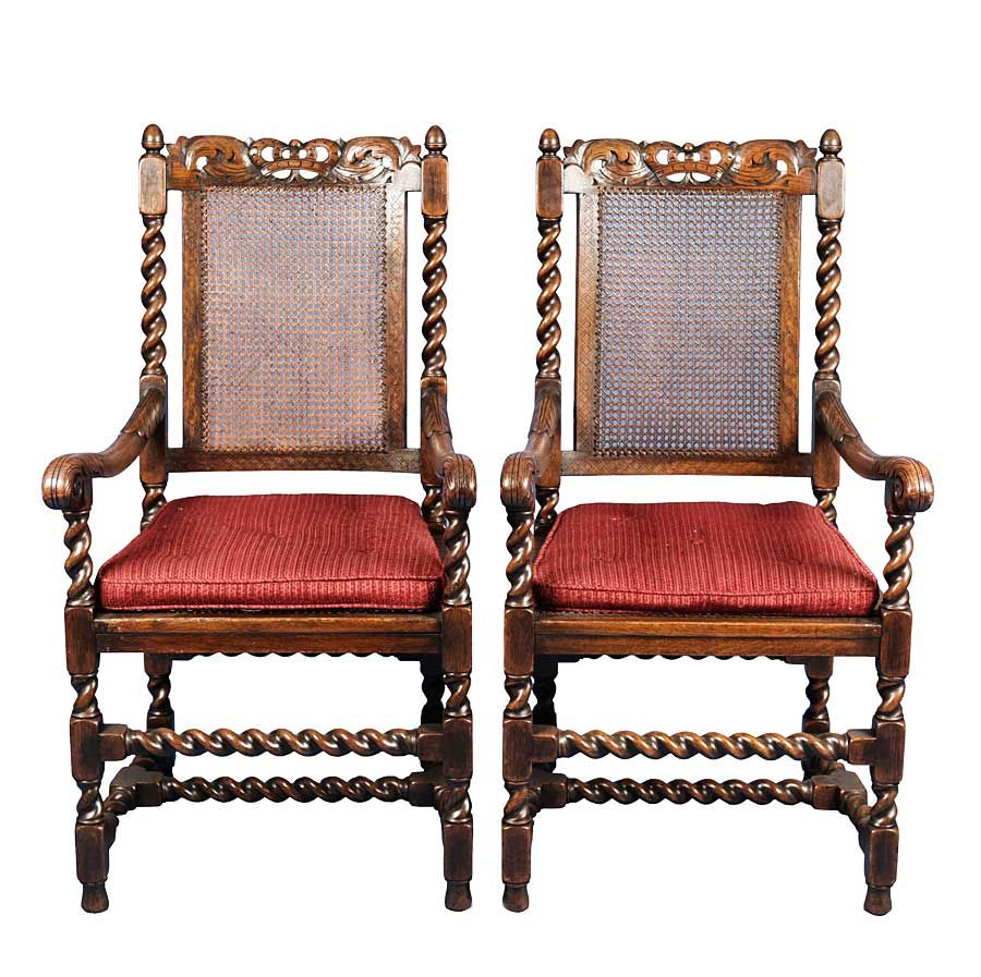 Antique pair of king and queen carved oak dining chairs