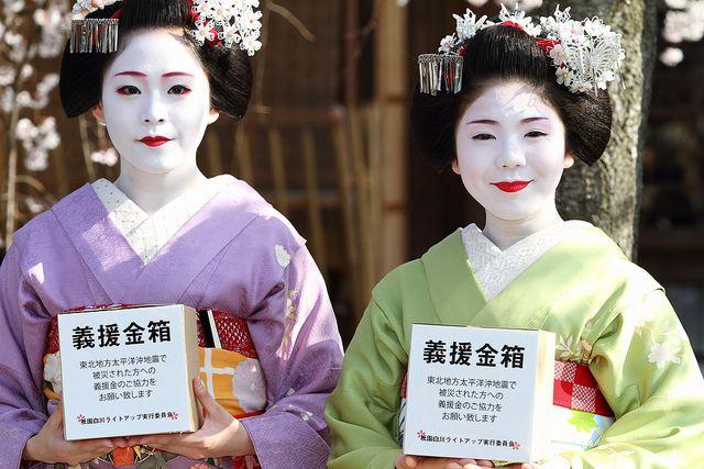 The Gion-Kobu Maiko girls, Manaha (left) and Tsuruha (right) have fund-raising campaign for many tsunami evacuees on the street of Gion-Shirakawa, Kyoto.