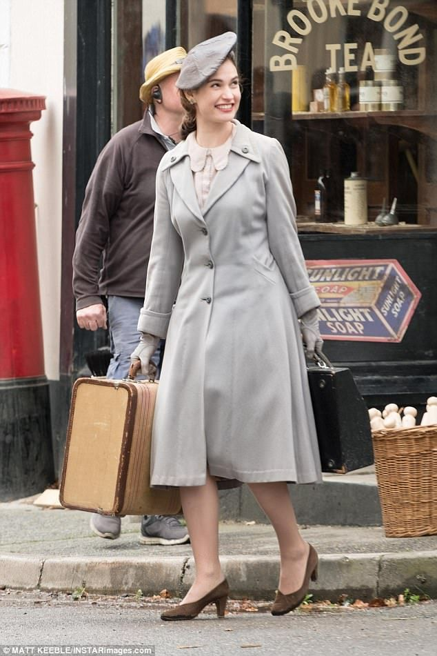 221efbc20450 Period fashion: Lily James appeared to be in high spirits on Friday when  she filmed scenes for Second World War movie Guernsey alongside actors  dressed as ...
