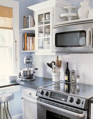open shelving above microwave kitchen