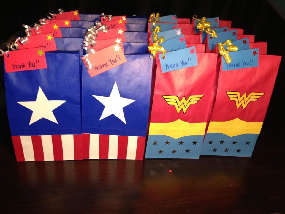 Wonder Woman Party Bags | The bags after they're filled with goodies. I hole punched the corners ...