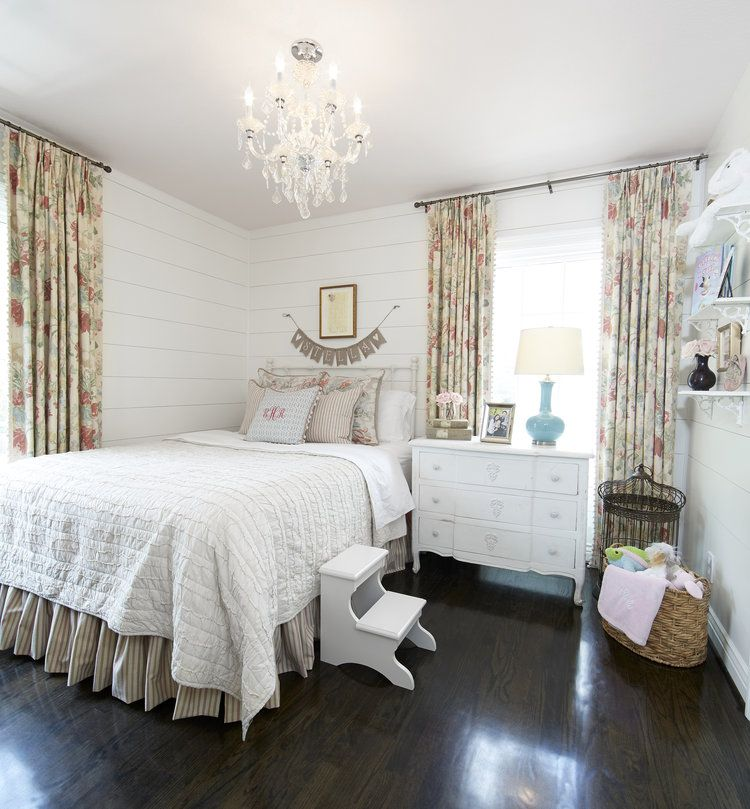 Beautiful girls farmhouse bedroom with planked walls, floral