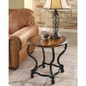 http://www.amazon.com/Ashley-Furniture-Wycliffe-Round-T256-6/dp/B0012FAFPM/ref=pd_bxgy_hg_img_b