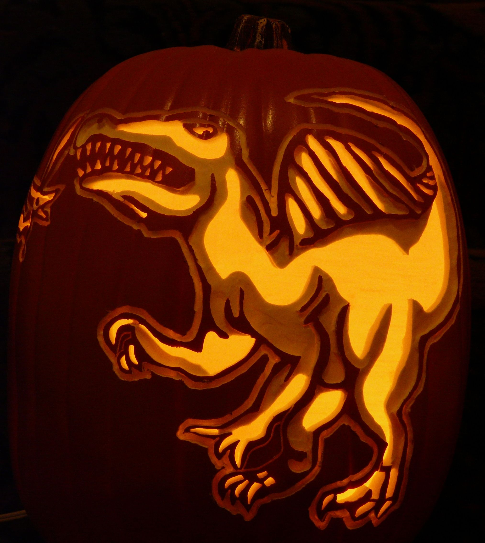 my 3 year old grandson wanted a spinosaurus pumpkin so i carved