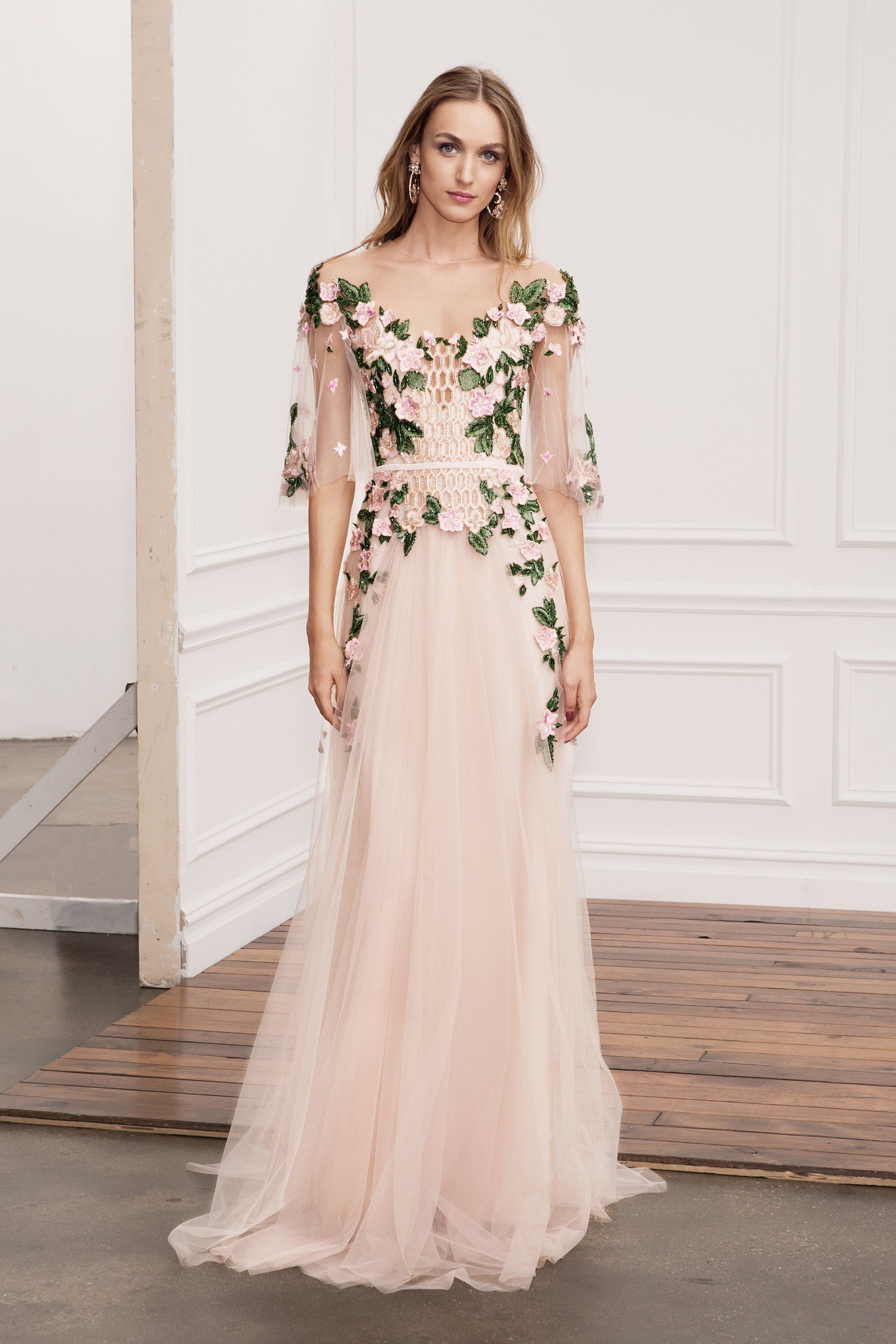 f3caddd2eb Marchesa Notte Spring 2018 RTW: Ethereal blush gown with intricate floral  details on the bodice.
