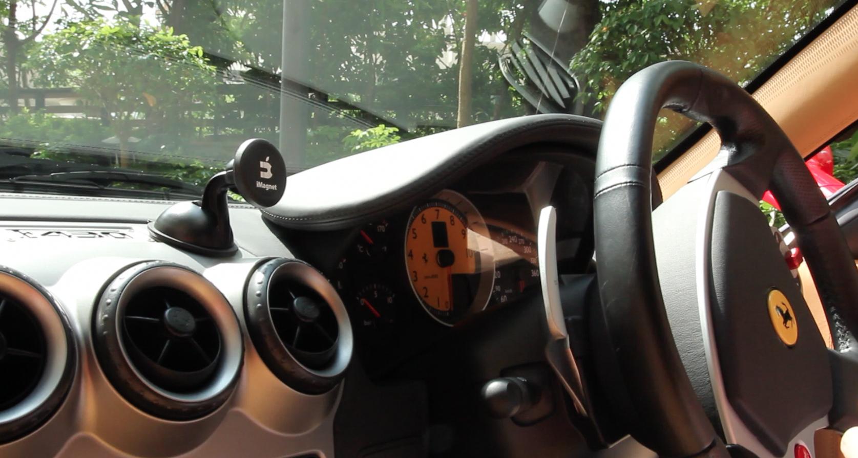 An Imagnet Car Phone Holder Mount On A Ferrari Luxury Exotic Car