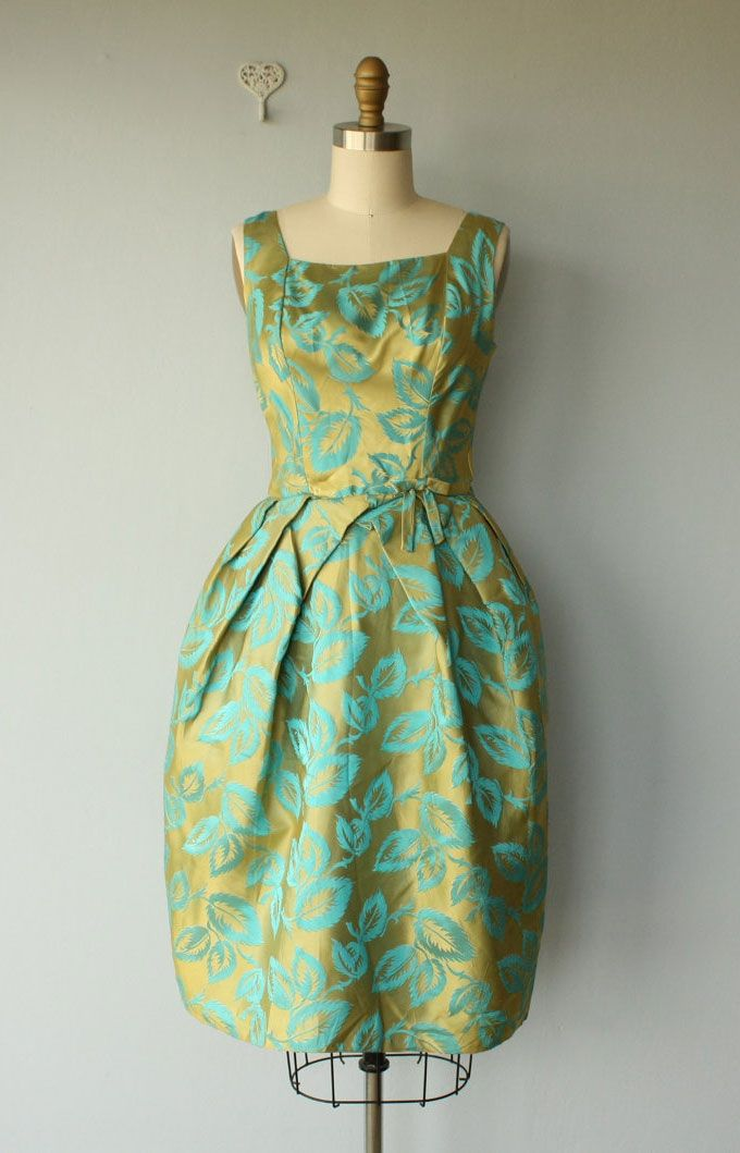1950's green and gold dress - this design would make a nice bridesmaid dress. It reminds me of Lyndie a bit. Done in solid turquoise dupioni instead of a pattern, though, it wouldn't be quite as sich. Might need some trim or something.