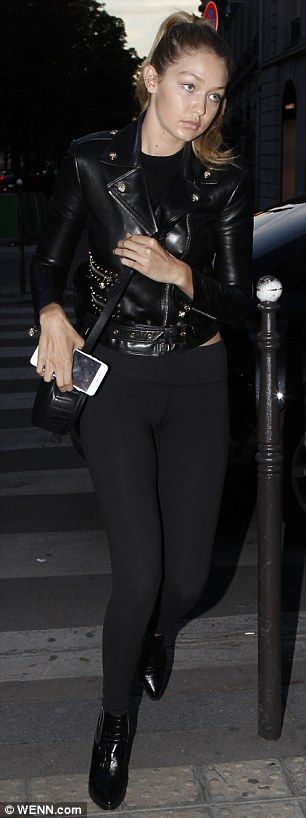 Turning heads: She dressed her lean and slender frame in tight black trousers and a trendy leather jacket