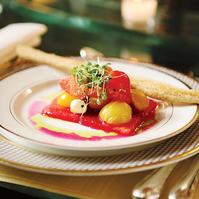 A watermelon and heirloom tomato salad. Courtesy of Di Bezi Photography.