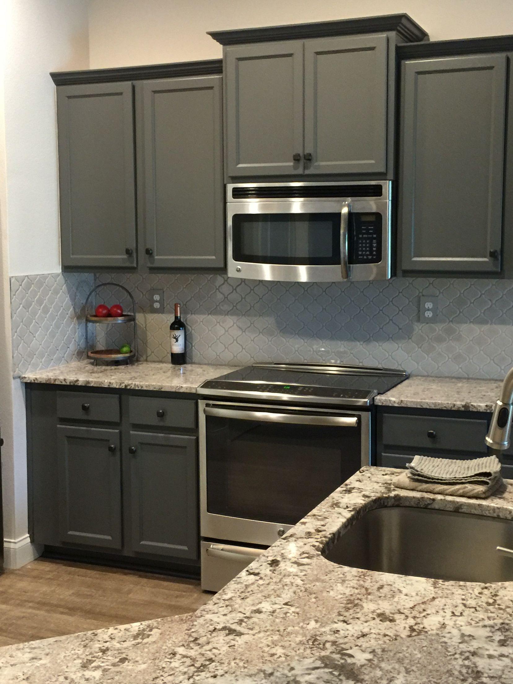 Remodeled Kitchen Painted Cabinets For An Inexpensive Fix To Builder Grade Cabinets Slide In Stove G Glass Tile Backsplash Kitchen Tile Backsplash Backsplash
