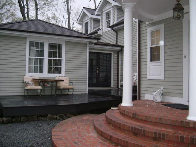 Reverse gray black and white trim deck against brick