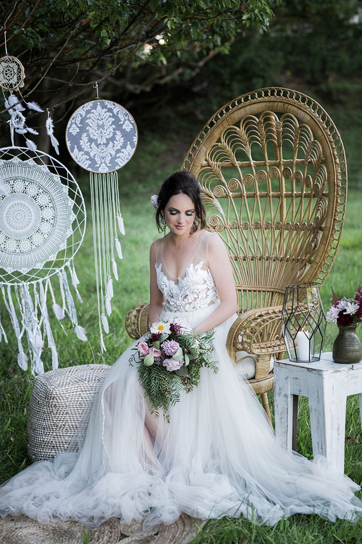 Rustic boho wedding inspiration in blush and olive peacock chair