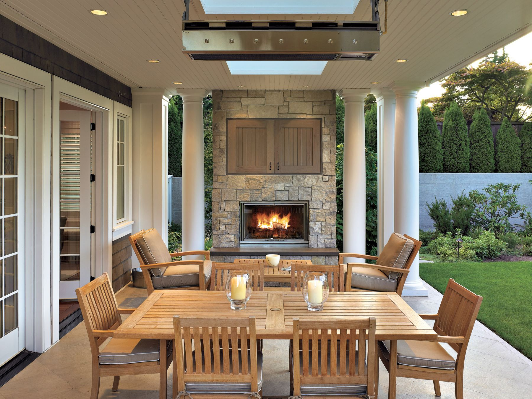 fabulous outdoor dining area with fireplace and hidden tv