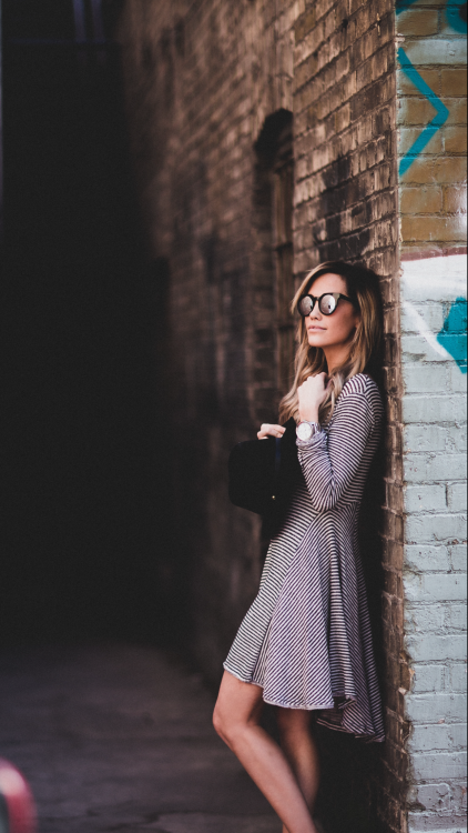 justthedesign:Striped Outfit Ideas: Megan Anderson is wearing a long sleeved pinstripe Urban Outfitters dress