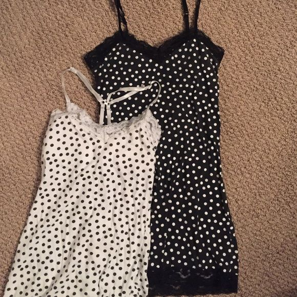 Polka dot camis w/built-in bra and lace edges Very stretchy! Straps are adjustable as well as able to turn into a racerback tank if need be! They are being sold for $5 each or both of them for $7. No Boundaries Tops Camisoles