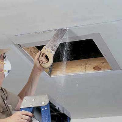 Cutting Out Attic Access Opening With A Drywall Handsaw