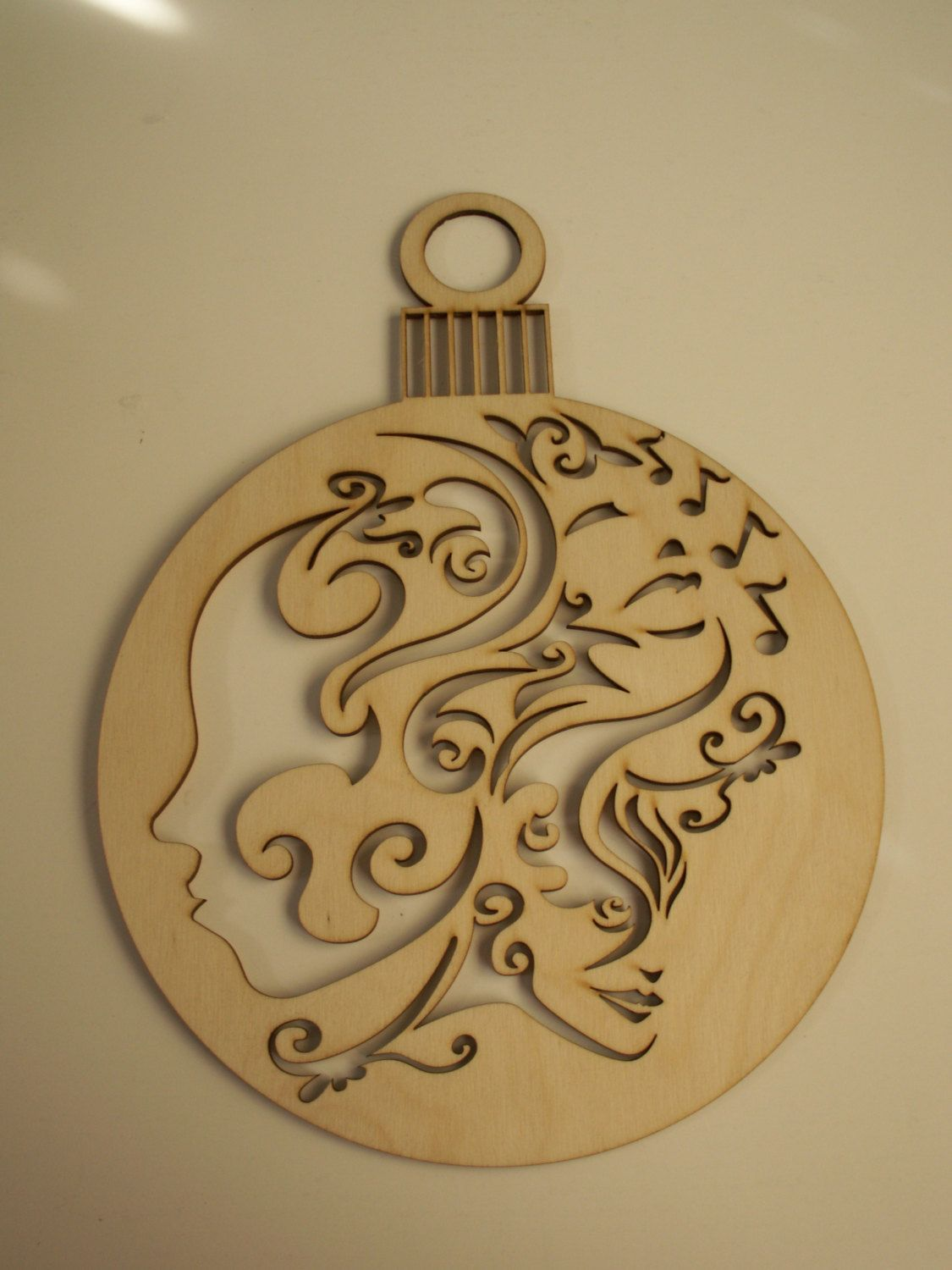 large christmas ornament wood shape with music notes laser cutouts