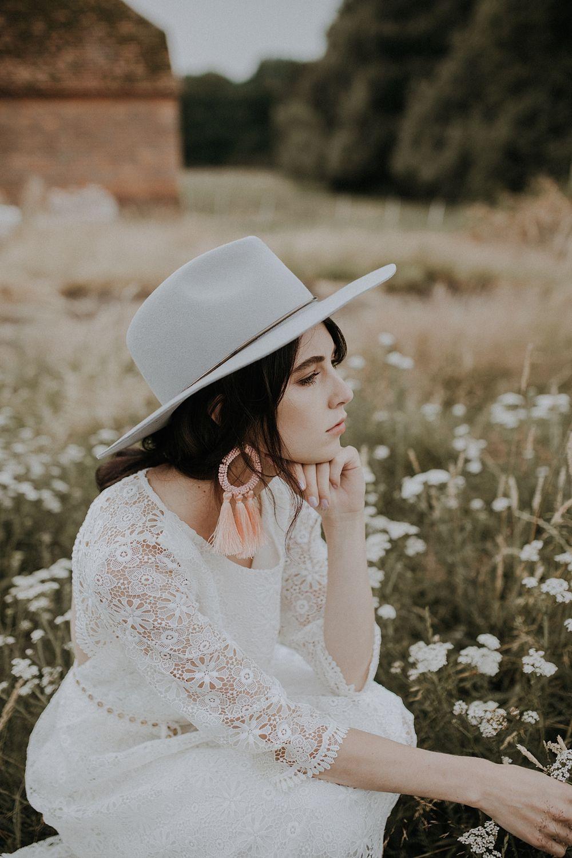 46f088e4384 Bride Bridal Fedora Hat Grey Accessory Tassel Earrings Bohemian Woodland  Wedding Ideas Lola Rose Photography #WeddingDress #WeddingGown #Bridedress  ...
