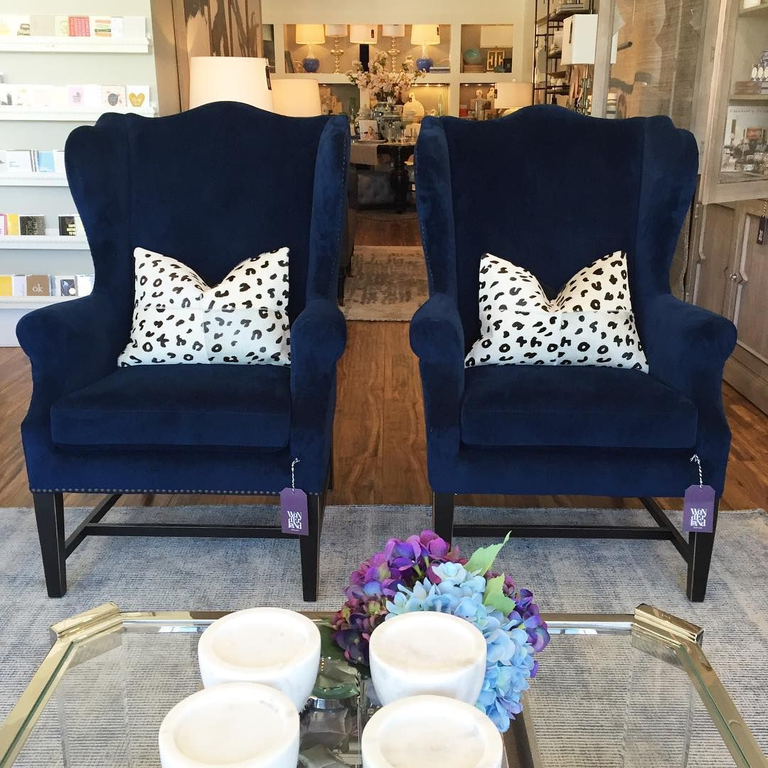 navy blue wingback chair with black painted legs | design