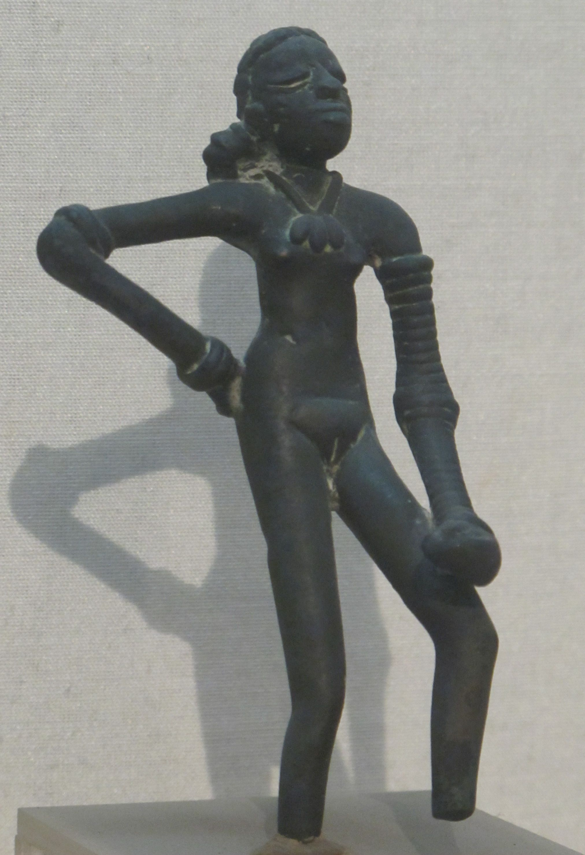 dancing girl bronze figurine from the site of mohenjo daro  dancing girl bronze figurine from the site of mohenjo daro