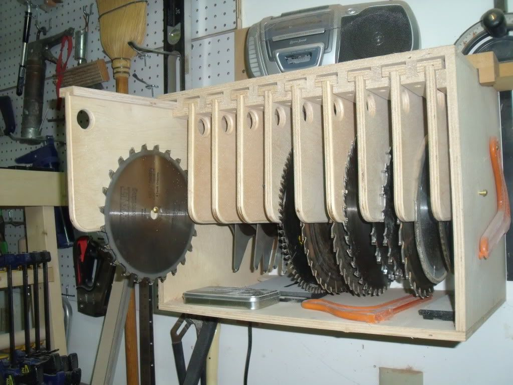 good idea for saw blade storage. a dowel notched or with a