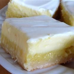 Cheesecake Lemon Bars ~ A light lemony cheesecake dessert that makes two layers, one lemony layer, and another cheesecake layer. You'll be coming back for more!!