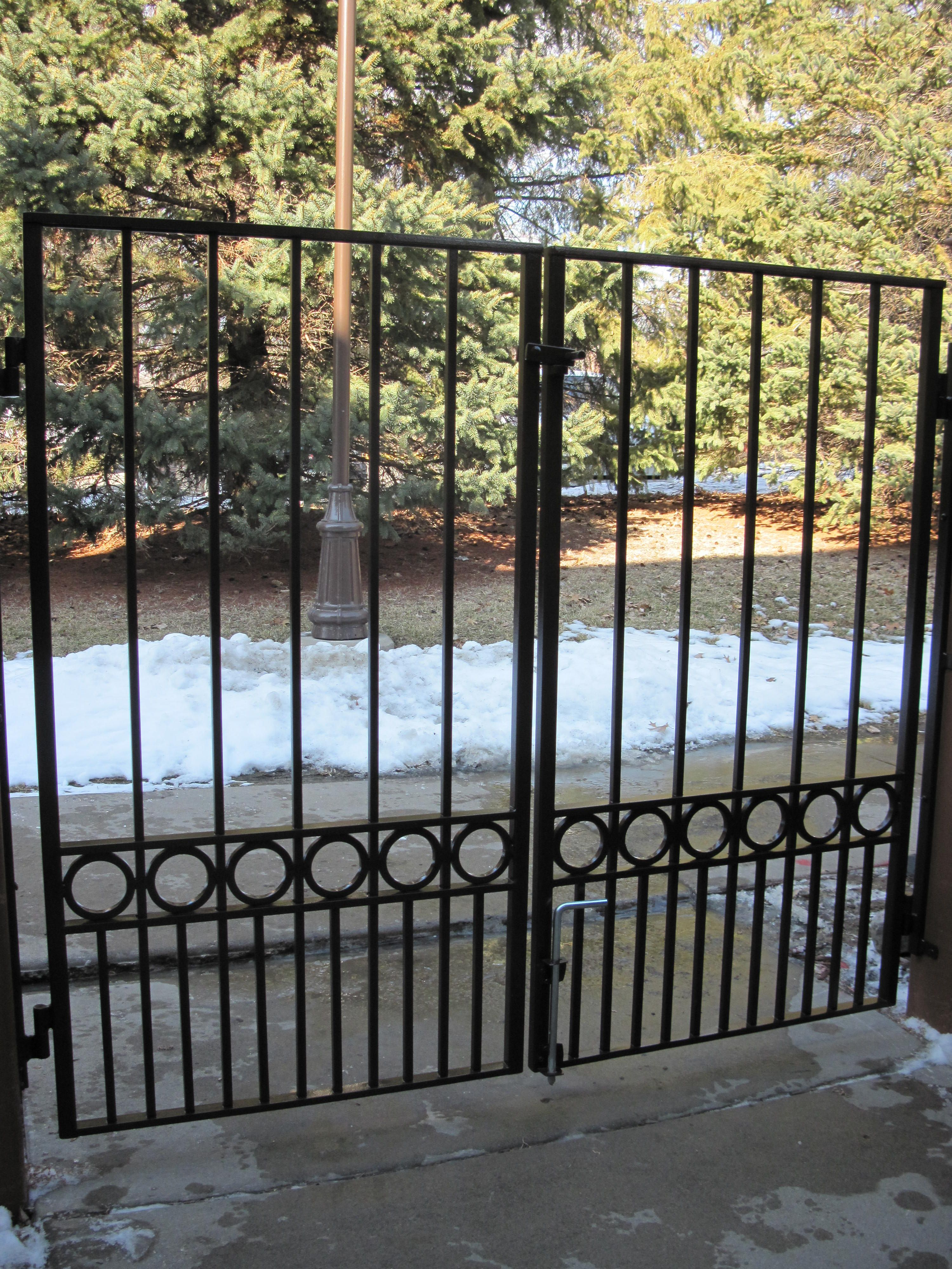 Double Iron Gates For Patio Area. Close Spoke Spacing At Bottom Meant To  Keep Cat