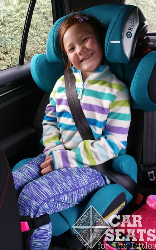 Kiddy Cruiser 3: Smiling 7 year old buckled in to teal booster seat ...