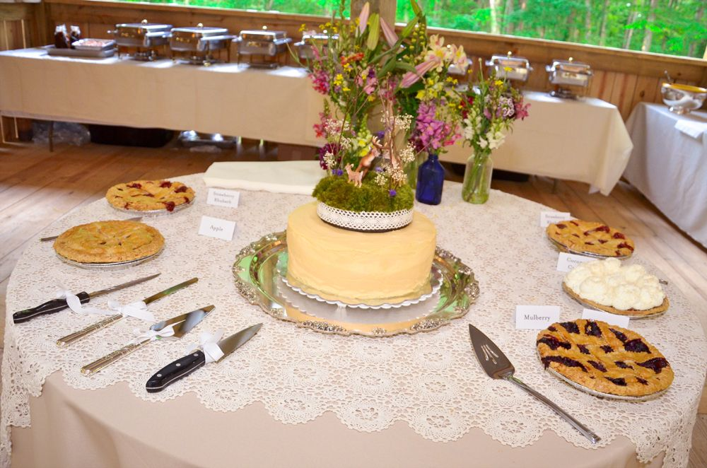 5 pies and a homemade peach & blackberry cake completed our wedding dessert table. The cake topper was a deer family, which apparently got drunk before dinner, because they were lopsided in this picture. :(