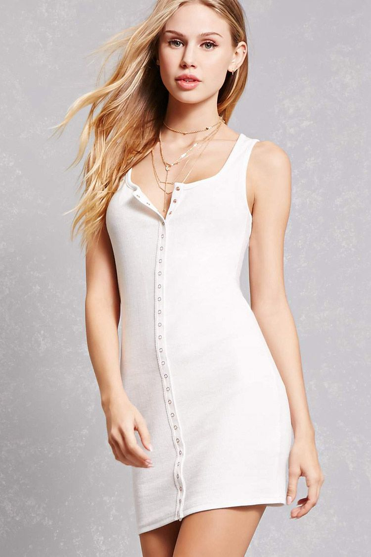 A ribbed knit mini dress featuring a round neckline snapbuttoned