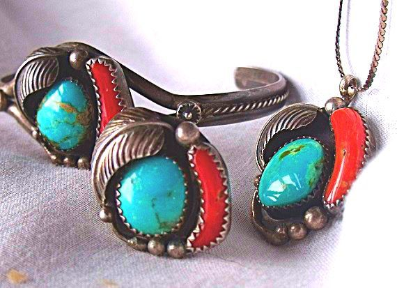 This is a Set of Navajo Jewelry signed LS believed to be Larry Sandoval, a Demi Parure of Native American Turquoise Jewelery with Branch Coral set