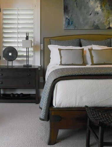 Like the masculine mix of woods with the refined bed linens (via Houzz)