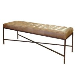 Jonathan tufted upholstered otoman with antiqued metal frame.