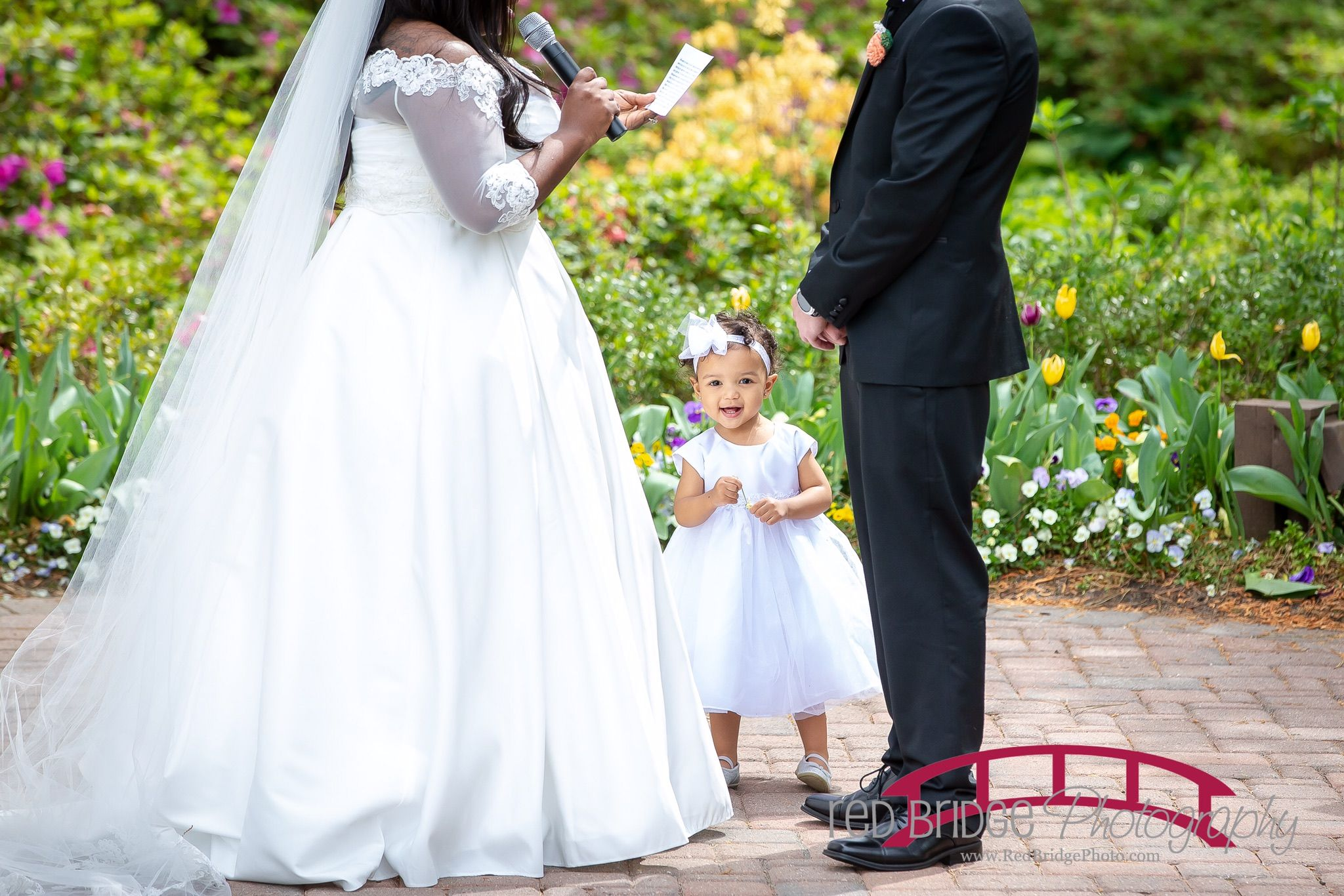 David bridal wedding dress  Davidus Bridal toddler flower girl Lil Kori photo bombing mom and