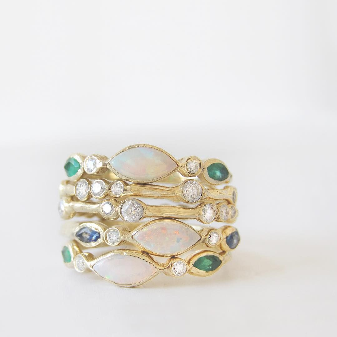 The mystical glow of the Aurora Rings combined with the twinkling stars of the Constellation Eternity Rings form a celestial, dancing light party on your hand. ~ Misa Jewelry