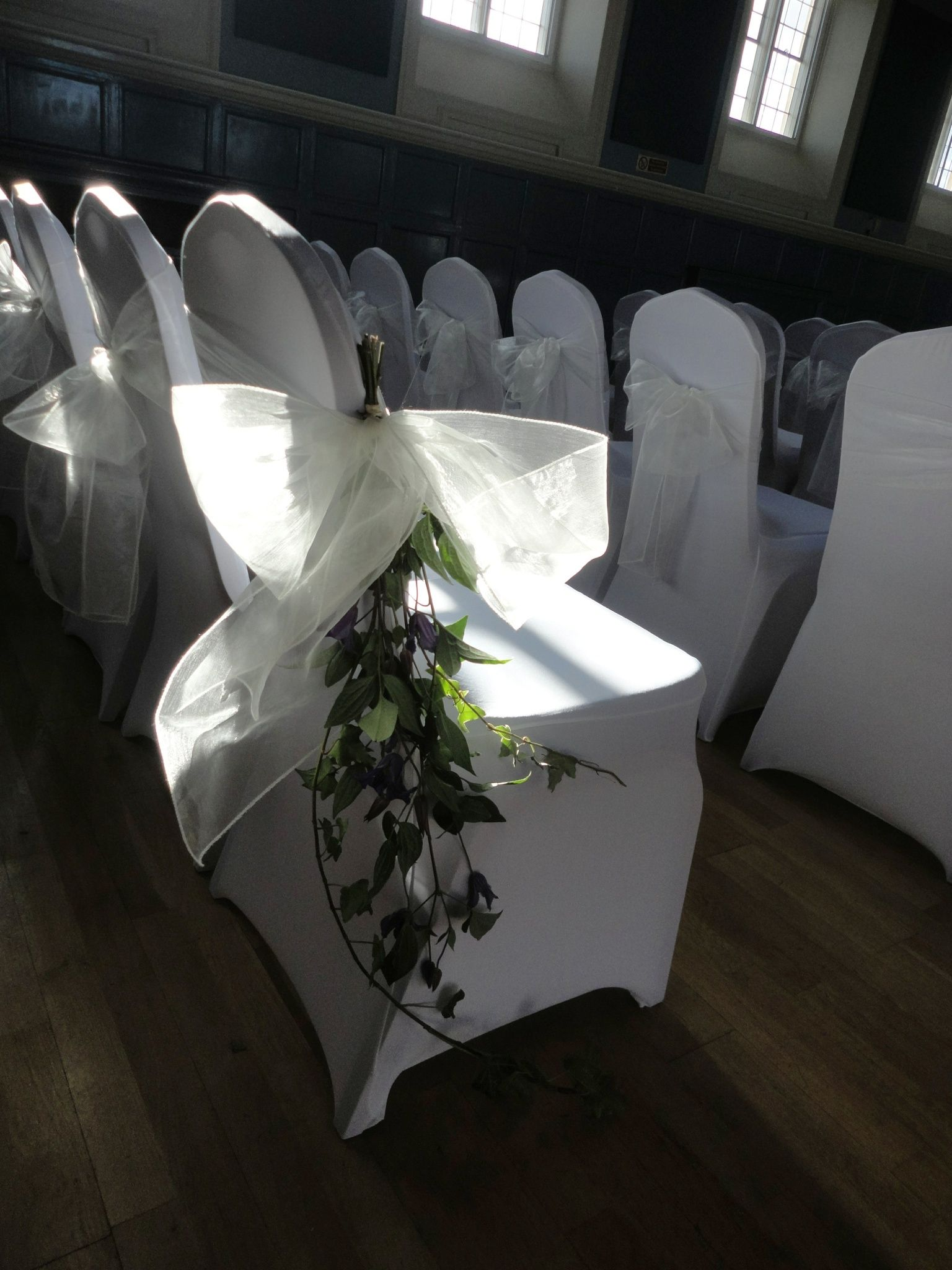 Stretch fitted chair covers with vanilla organsa chair bows by