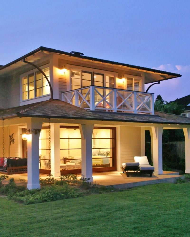 Behind this cute little beach house is the beautiful for What is a lanai in a house