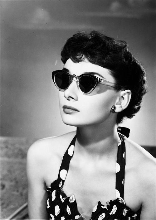 Audrey Hepburn in sunglasses photographed by Angus McBean, 1950s.