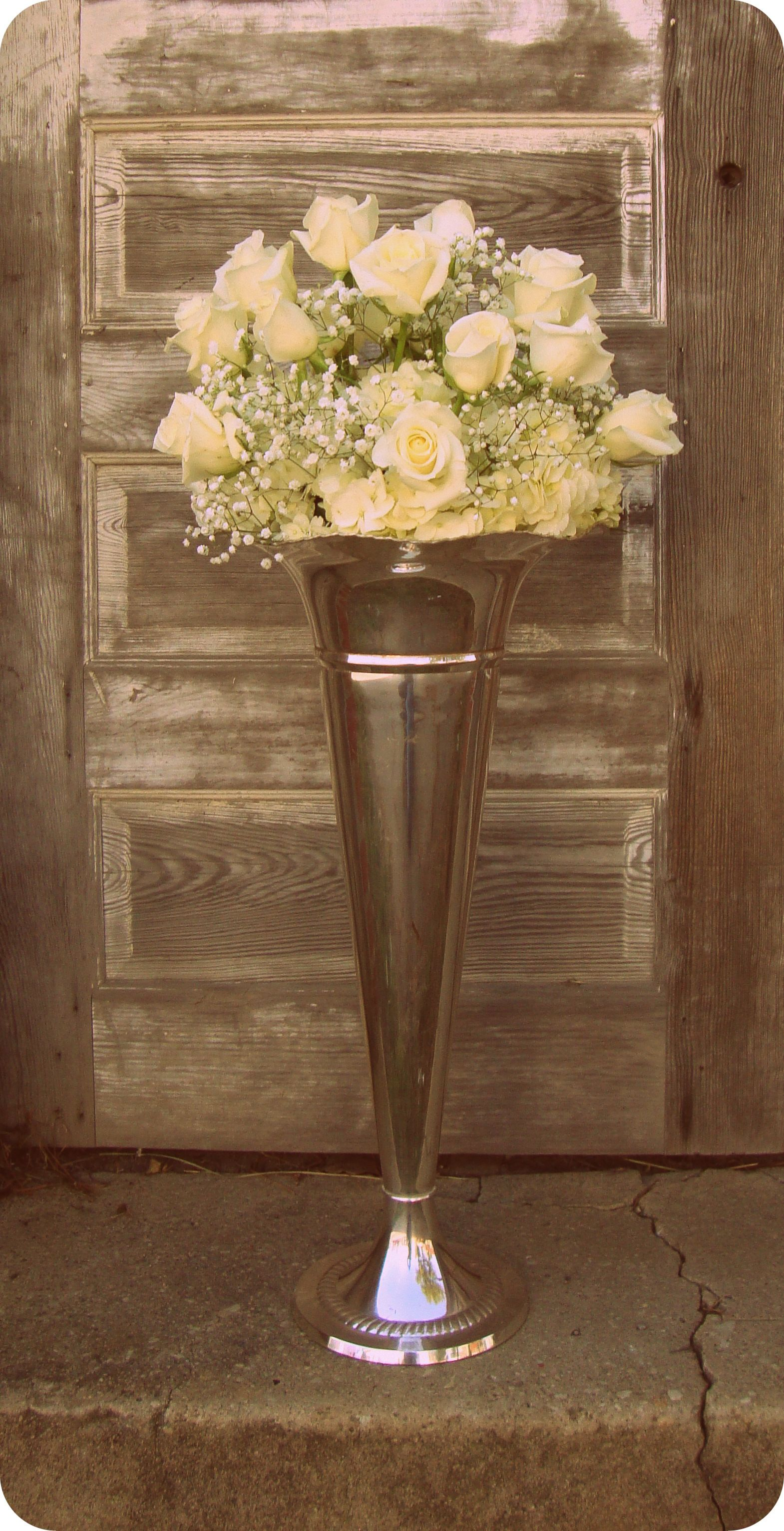 Tall centerpiece in silver pilsner vase roses babys breath tall centerpiece in silver pilsner vase roses babys breath reviewsmspy