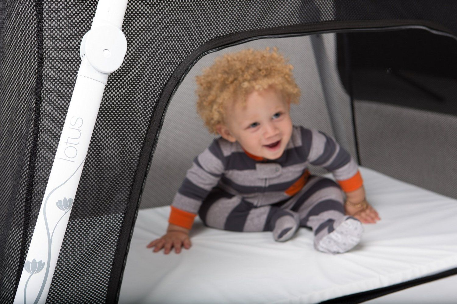 The Lotus Travel Baby Crib And Portable Baby Playard Is