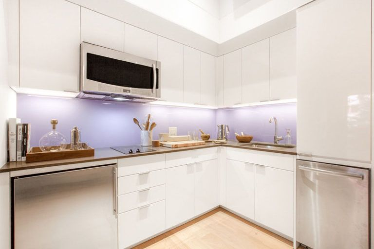 Kitchen Design Ideas - 14 Kitchens That Make The Most Of A Small Space // This bright kitchen may be small but it includes of the essential appliances and ample storage to help keep it tidy and organized.