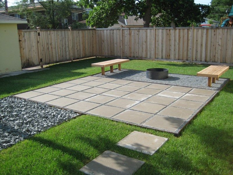 Contemporary paver patio in a cleanlined yard Decoist