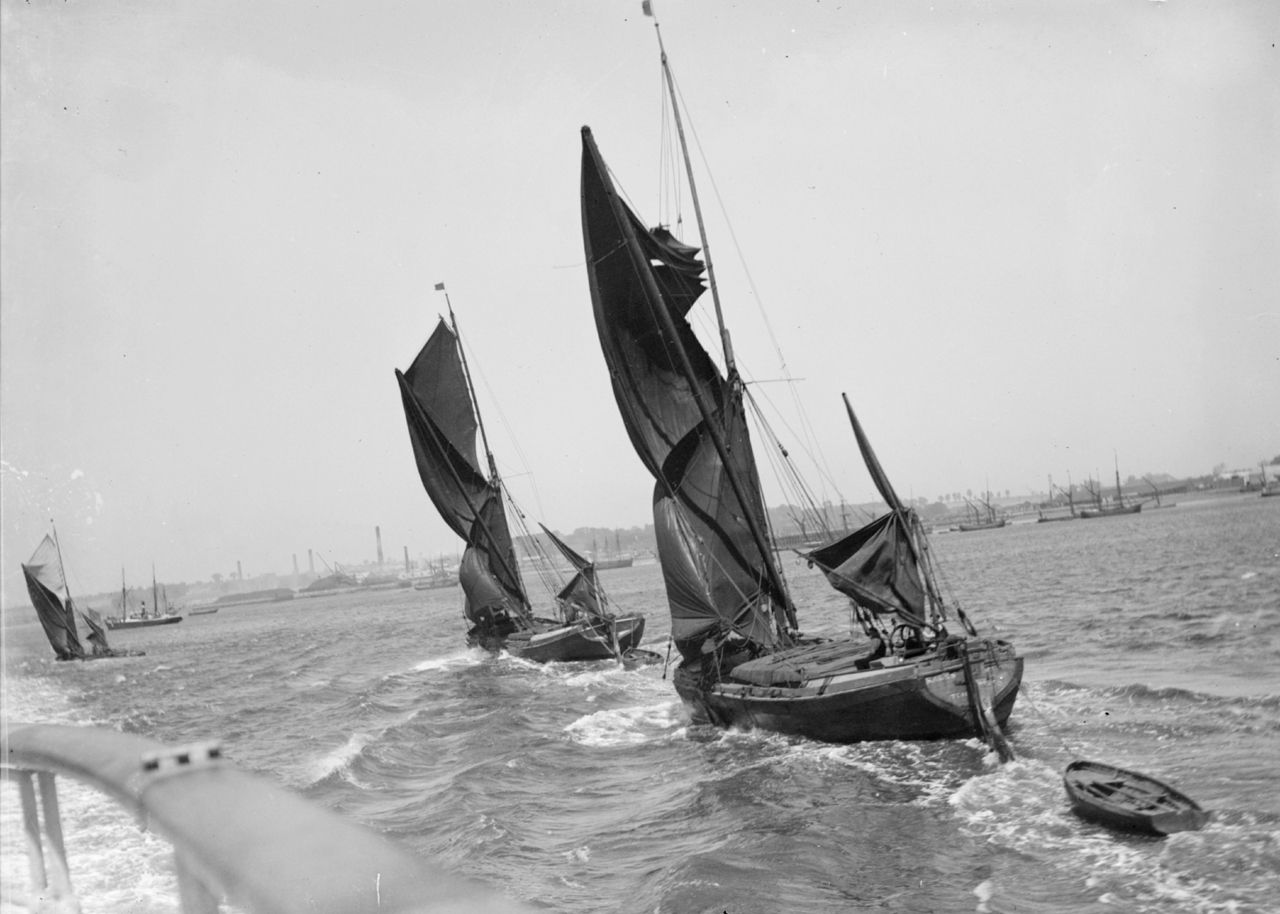 Thames sailing barges off Northfleet, taking in  sail in a blow - National Maritime Museum
