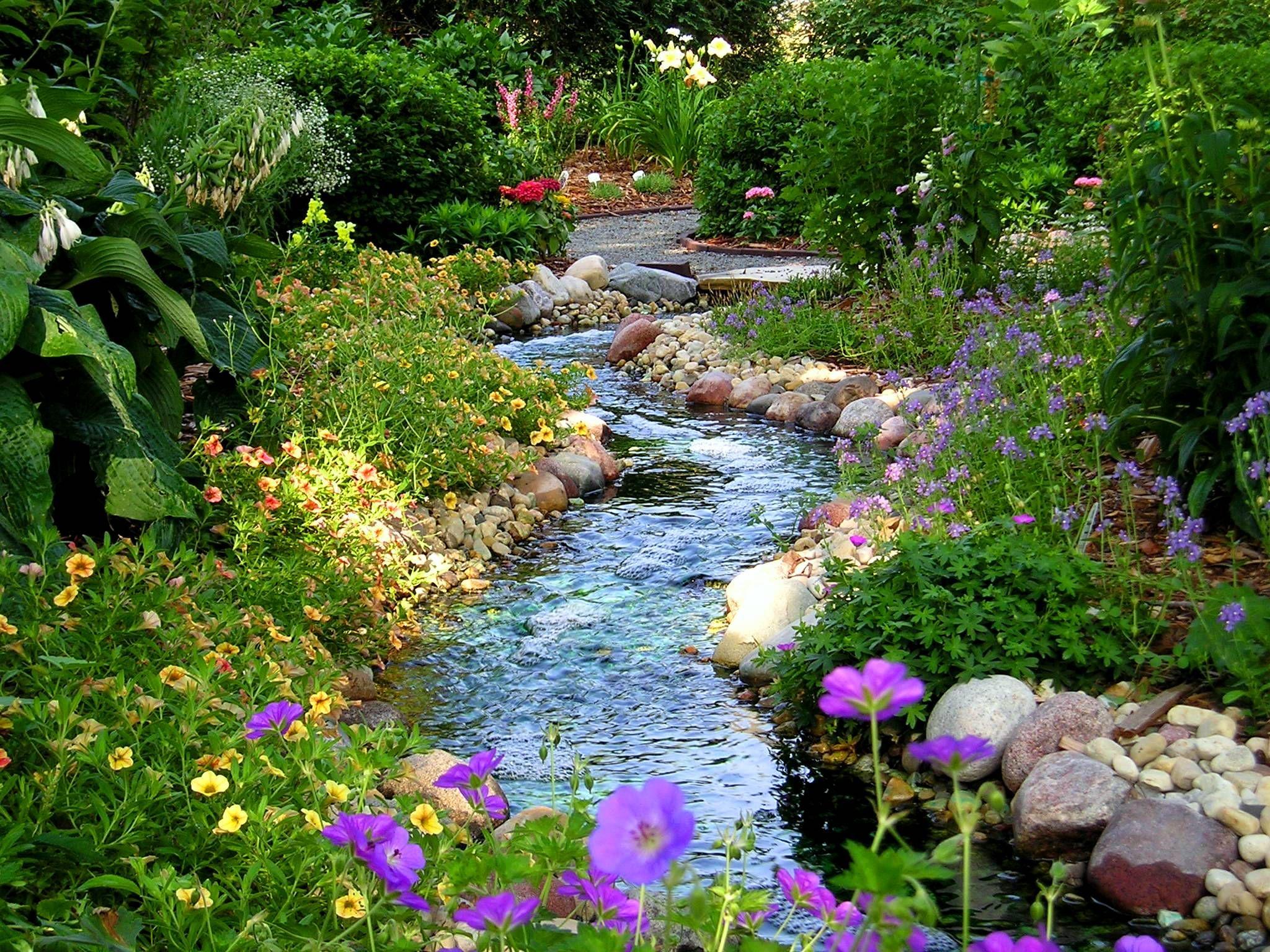 A long stream bed meanders through the garden