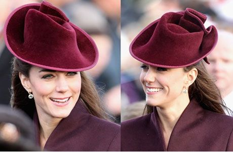 "Kate's hat (pictured above) is by Jane Corbett, the milliner who created the pale blue hat worn by Kate's mother Carole for the royal wedding. Corbett, based in Hungerford, Berkshire, describes herself as a ""couture milliner and artist"" on her website.    Corbett has been making hats for over 15 years and was trained by Rose Cory, the late Queen Mother's milliner."