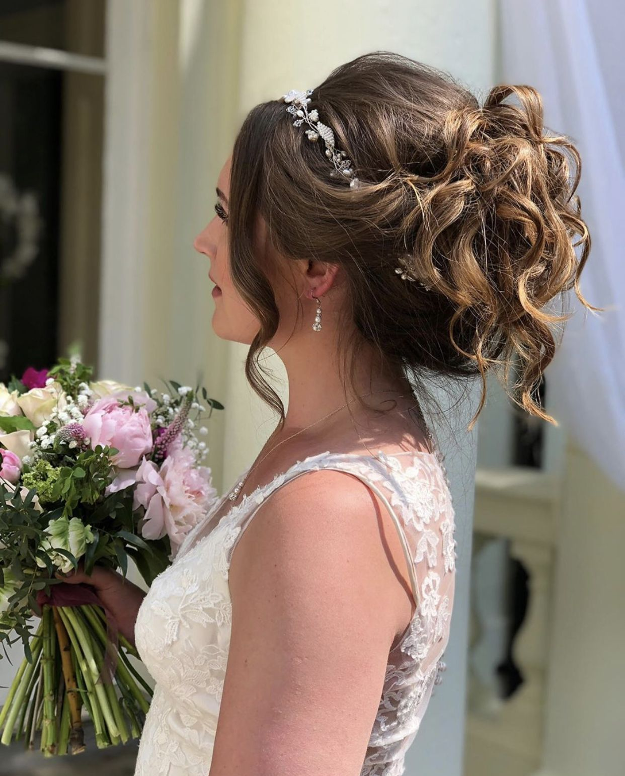 Romantic bridal updo with hair vine in 2020 | Bride updo, Thick hair styles, Hair and makeup artist