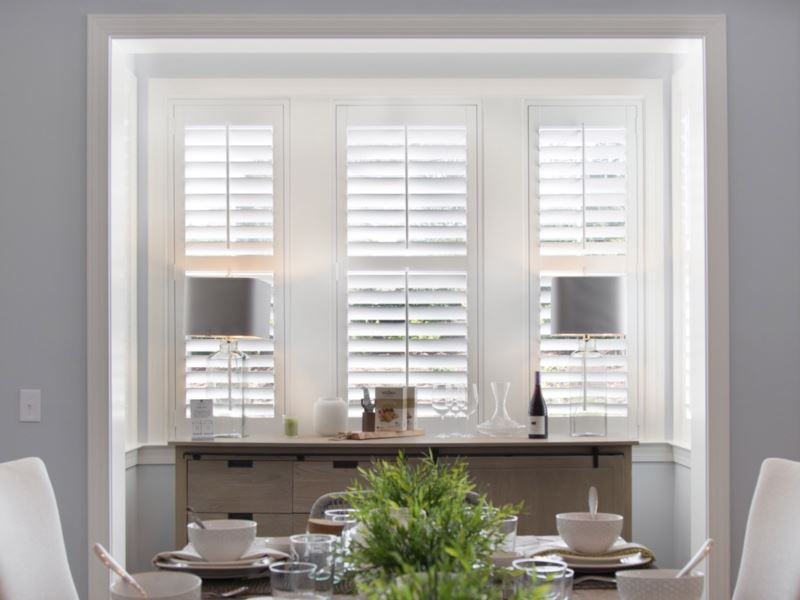 White Shutters In A Contemporary Dining Room Interior Doors For