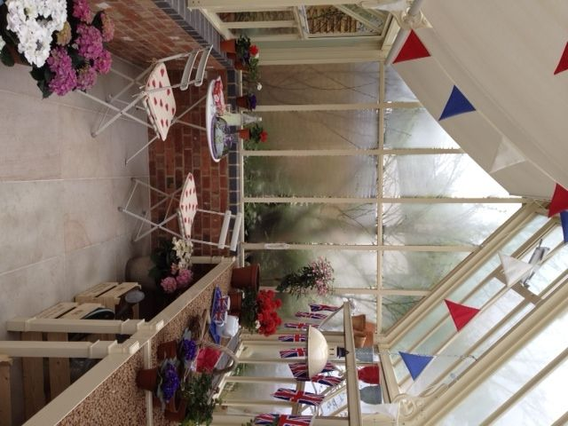 Traditional English greenhouse with bunting ready for the Jubilee.
