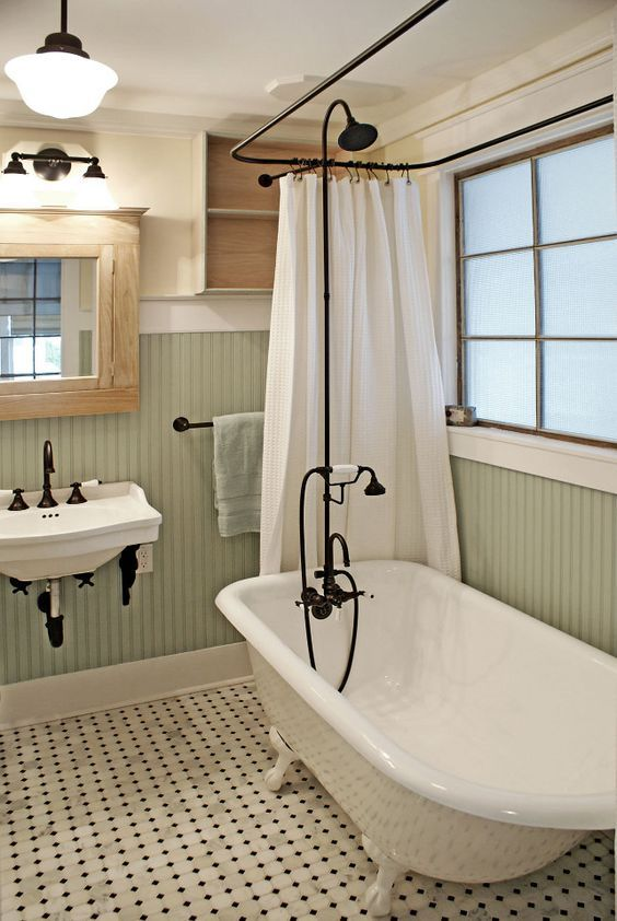 Vintage Inspired Bathroom With A Clawfoot Tub And Black Accents To Pull Everything Off Tiny House Bathroom Craftsman Bathroom Clawfoot Tub Bathroom